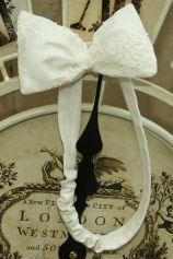 """Headband with laced bow for baby girls and toddlers, matching the """"Little Swan"""" dress."""