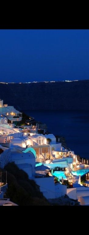 I want to sit in a window wrapped in my lovers arms in Santorini, Greece