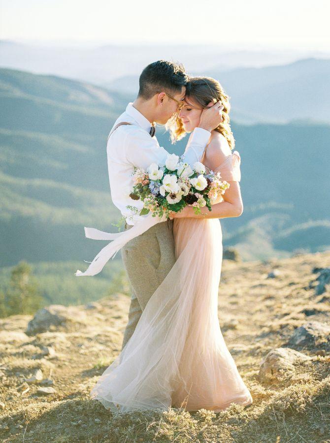 Scenic mountain top elopement inspiration: http://www.stylemepretty.com/little-black-book-blog/2015/11/17/pastel-mountain-elopement-inspiration/   Photography: Alexandra Grace - http://www.alexgracephotography.com/