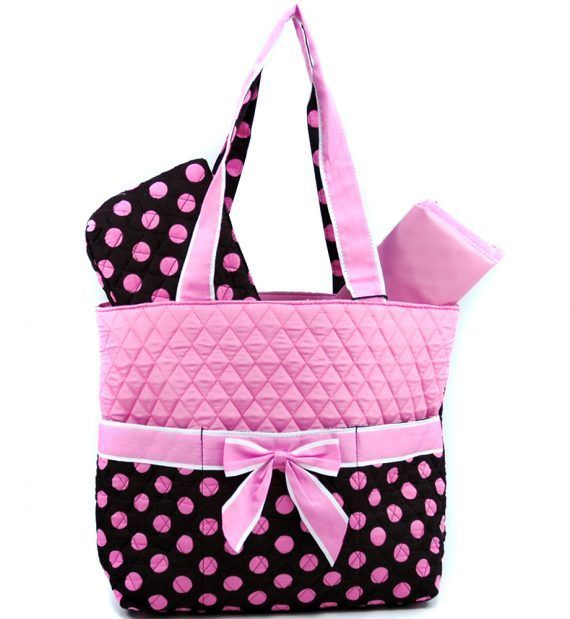 Perfect tote bag for moms on-the-go!- Quilted cotton fabric- Zipper top entry- Dual shoulder straps with 7″ drop length- Gingham style interior lining- Front pockets- Back zipper pocket- Inside side zipper pocket and cell phone pocket. Material...