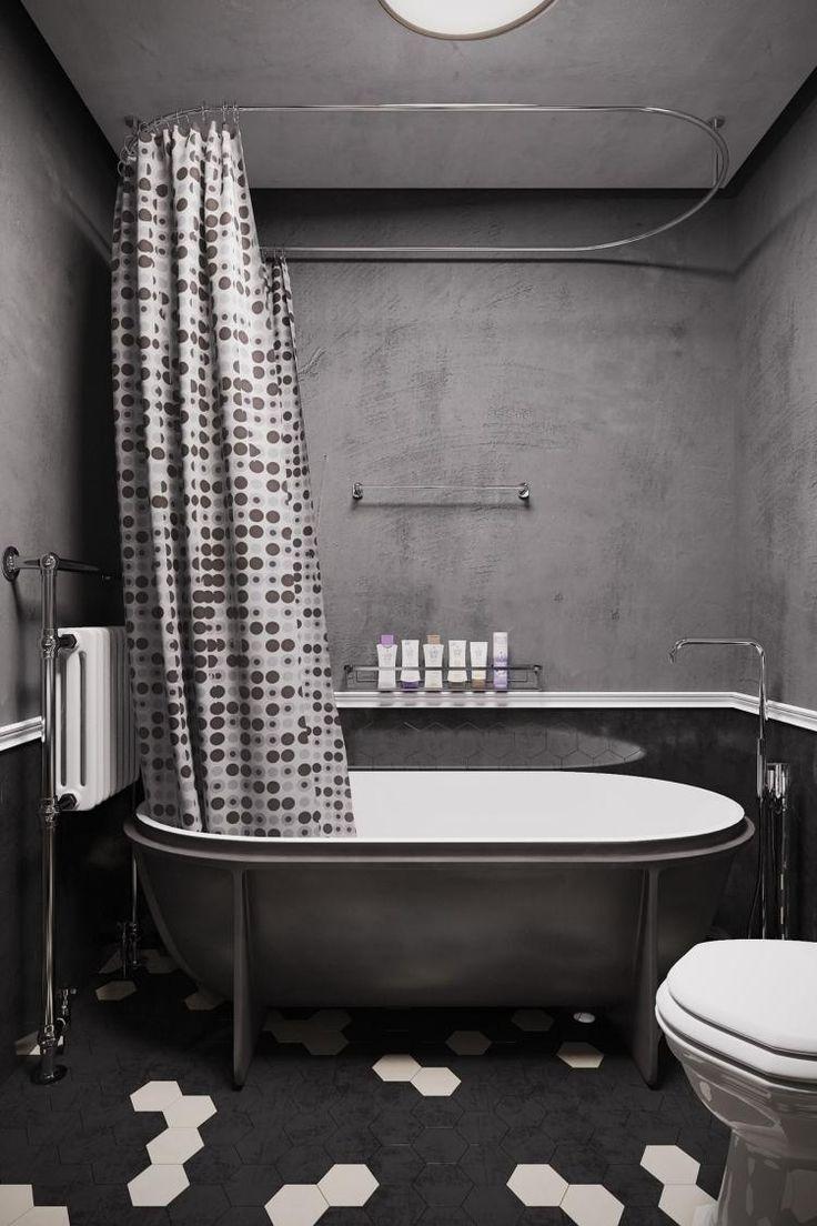 salle de bains grise avec rideau à pois et carreaux haxagonales