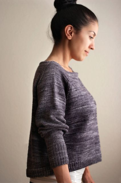 This loose fitting raglan sweater is a great garment to throw on over any top or to simply wear alone.