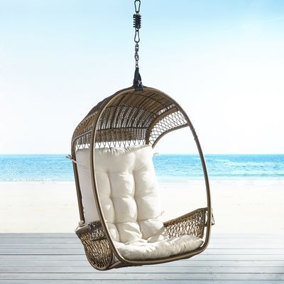 Hippy, happy and fun? Sure thing. But also: Durable and downright practical. After all, our outdoor Swingasan® features an airy, open-weave back, side compartments for your drink and a canopy that provides cool, cool shade. All in weather-proof synthetic rattan that's been woven by hand over a sturdy, rust-resistant iron frame. Stand and cushion sold separately.