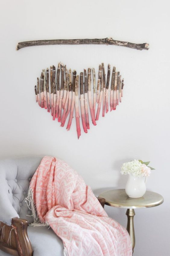 build a splendid heart shaped wall art out of branches