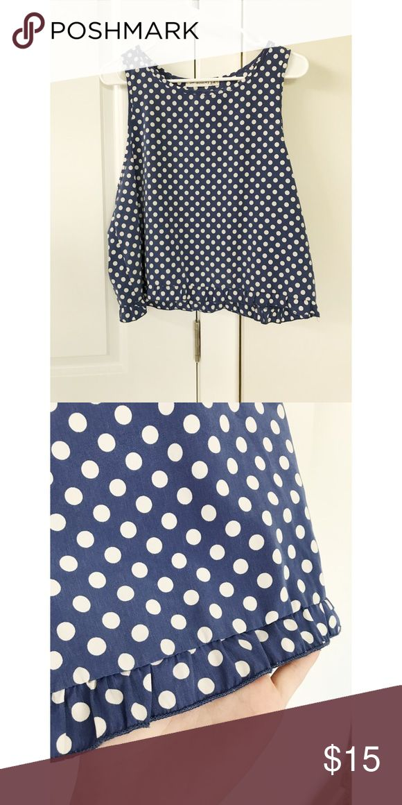 Polka dot crop with ruffle hem Blue and white polka dot crop! Super cute too and comes right to the belly button on me. Adorable ruffles at the bottom and nice fabric, feels like silk! You can really dress up or down!    #polkadot #tank #crop #top #dot #dots #pattern #design #ruffle #cute #blue #white Tops Tank Tops