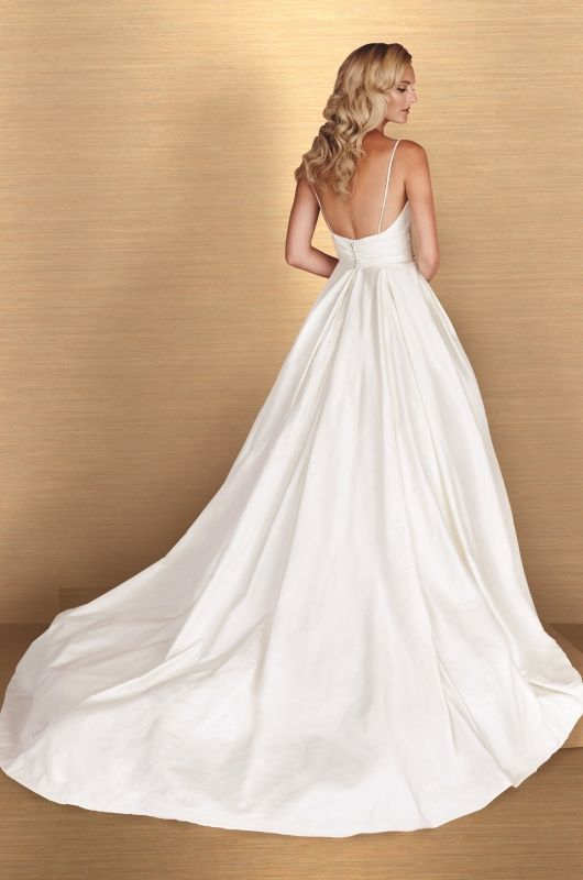 Paloma Blanca // Your Dream Bridal Sudbury Ma - Silk Dupioni Wedding Dress. Sleeveless draped V-neckline with beaded insert at front. Beaded spaghetti straps at back. Ruched at midriff with Swarovski buttons at back. Full box pleated skirt with side pockets. Cathedral Train. http://www.yourdreambridal.com/