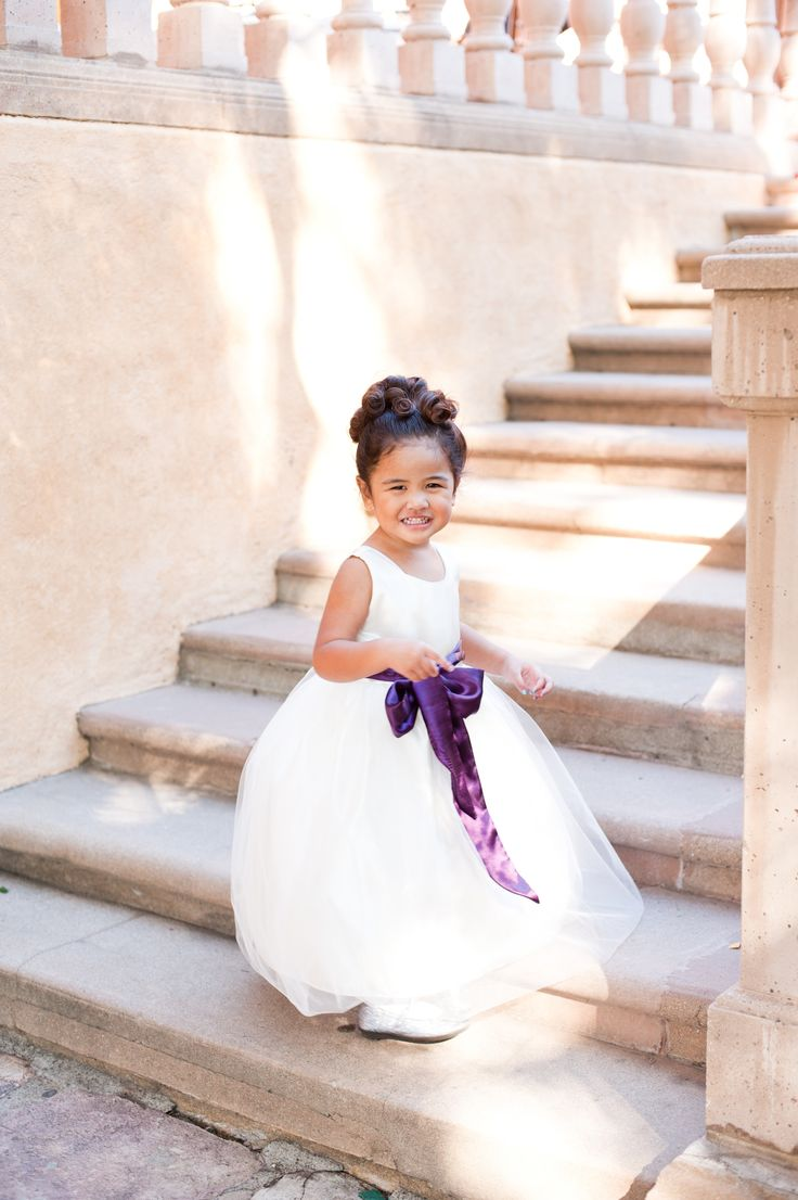 Flower girl in white dress and purple sash. Photography: Candice Benjamin Photography - candicebenjamin.com
