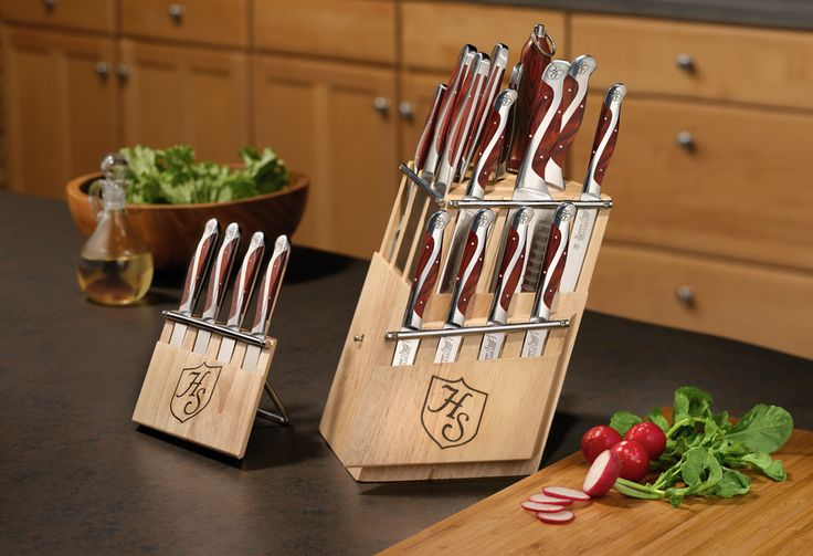 """The Ultimate Cutlery Collection. The stunning look will gain you numerous compliments while its exceptional design and performance will give you a lifetime of use. The set includes 3.5"""" paring knife, 7"""" Vegetable Cleaver, 4.5"""" Santoku, 7.5"""" Santoku, 8"""" Carving Knife, 8"""" Bread Knife, 10"""" Slicer, 5"""" Cheese Knife, Sharpening Steel, 8 Steak knives, two removable steak knife blocks & the beautiful V-Shape rotating Bamboo Display Block."""