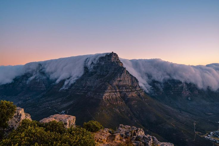 Cape Town you are amazing. Table Mountain and the 12 Apostles from Lion's Head. Photo by @mattfos and edits by me. #capetown #tablemountain #mountain #clouds #sky #sunset #southafrica #hiking #backpackers #backpacking #adventure #outdoors #adventureawaits #globetrekker #wanderlust #journey