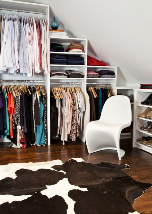 Suzie: Palmerston Design - Chic walk-in closet with brown cowhide rug, white Panton Chair and ...