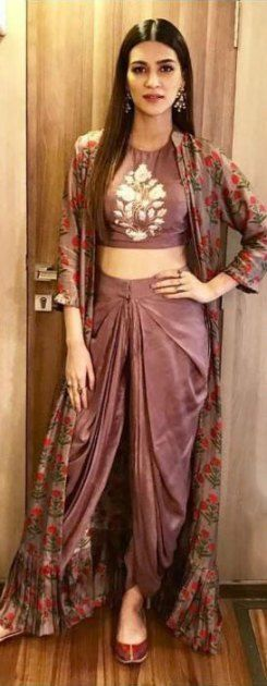 Diwali look | Bollywood inspired Diwali look | Bridal trousseau | Dhoti style pants with crop top paired with floral cape and juttis | Crop top with cape | Kriti Sanon | Minimal look | Bollywood fashion | Image source: Instagram | Every Indian bride's Fav. Wedding E-magazine to read.Here for any marriage advice you need | www.wittyvows.com shares things no one tells brides, covers real weddings, ideas, inspirations, design trends and the right vendors, candid photographers etc.