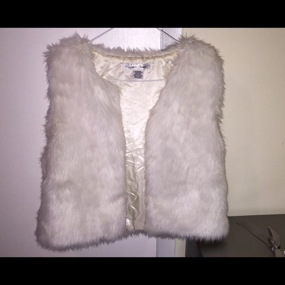 White Fur Vest All white fur vest in great condition. Worn 3 times. 3 clamps on the inside to close vest. Jackets & Coats Vests