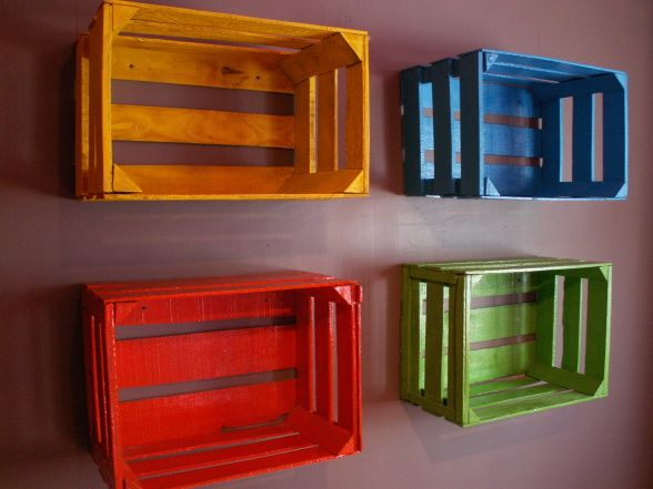 Brightly painted fruit crates for shelves.