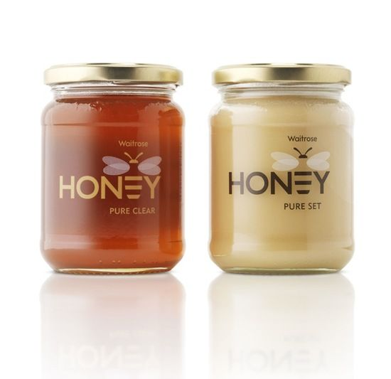 honey logo  packaging. love how the e is the bee. and the transparency on the left.