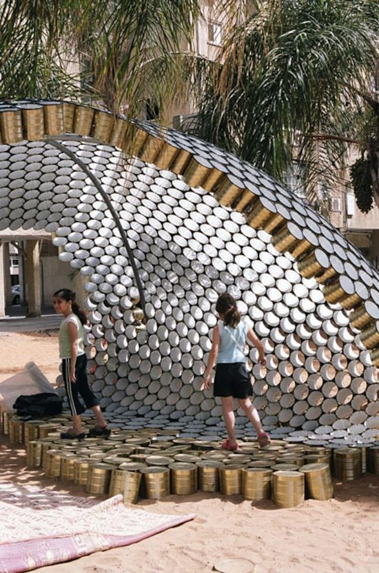 The Bat-Yam pavilion is a honeycomb like structure made of old soup cans. The pavilion transforms an otherwise unoccupied lot into an inviting public space.