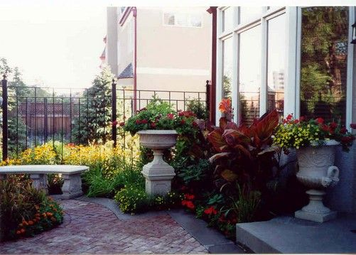 this italian courtyard garden was designed to compliment our clients newly constructed town home and incorporated a number of garden decorations