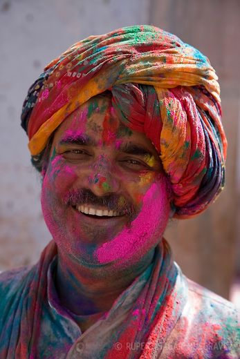 Man covered in coloured paint powder during the festival Holi in Udaipur, Rajasthan, India. Rupert Sagar Musgrave Photography
