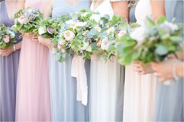 Soft blush, powder blue, soft pink and purple bridesmaids dresses | Mismatched Jenny Yoo |