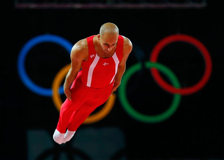 Peter Jensen of Denmark competes in men's gymnastics trampoline qualification in the North Greenwich Arena, Aug. 3, 2012. (Mike Blake/Reuters) #