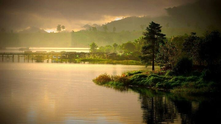 Sangklaburi in Rainny Season, Kanchanaburi Province. –--- One of the best places in Thailand to listen to the sound of drizzling rain, and immerse into refreshing atmosphere and the breathtaking of the misty lake.