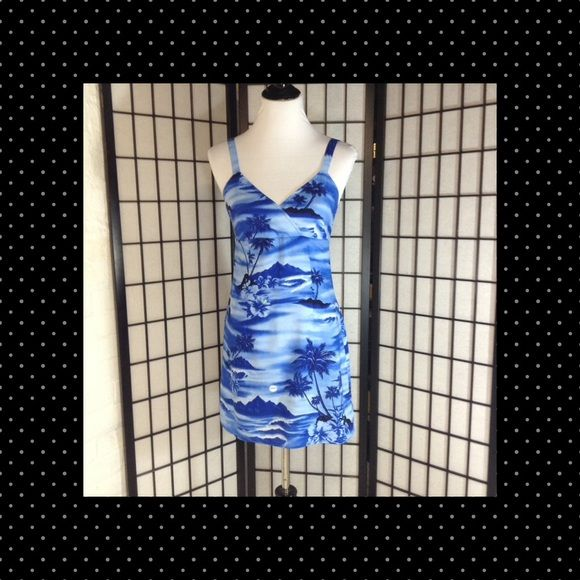 Aqua Blues Cotton Dress or Swim Cover Up EUC Beautiful shades of blue with touches of grass green. The fabric is cotton rayon blend. It features a crisscross empire waist bodice and has narrow straps. A perfect summer dress! Size 9 Aqua Blues Dresses Mini