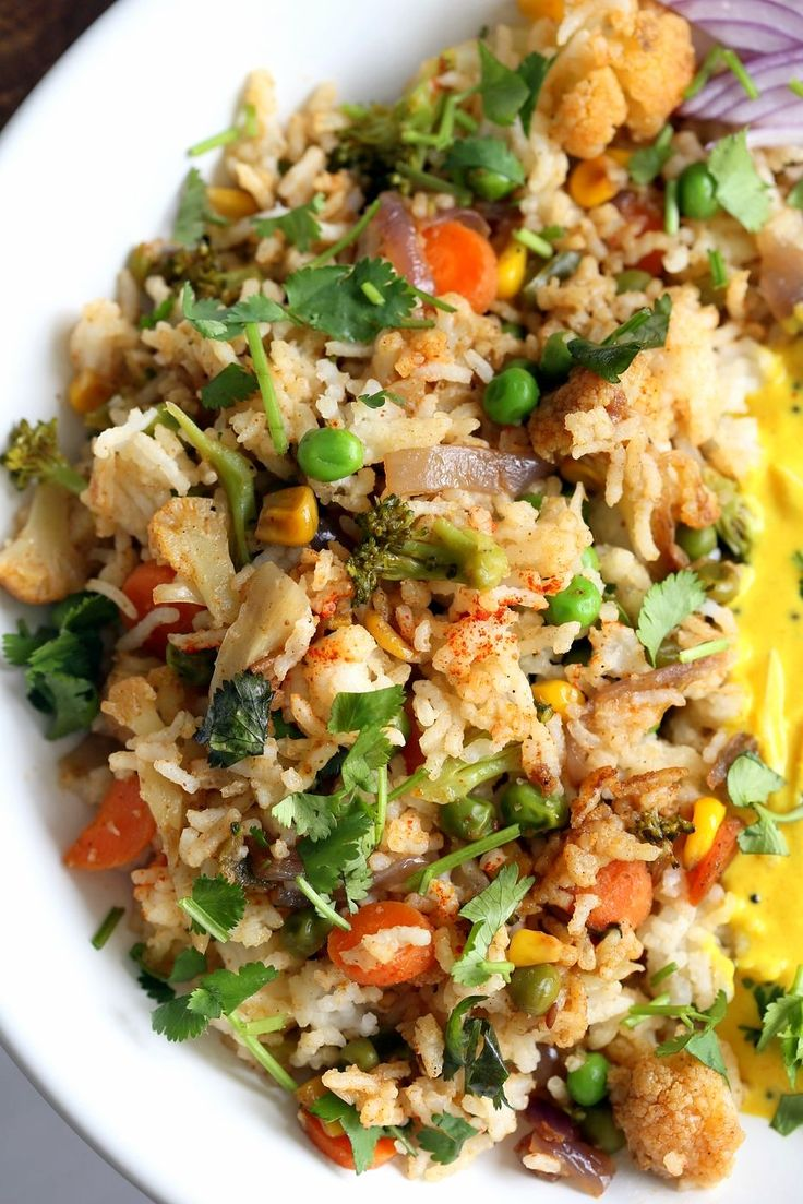 Indian Spiced Masala Veggie Fried Rice with Turmeric Onion Raita. Use up the leftover rice or grains to make this quick spiced fried rice and serve with a simple yogurt raita that is spiced with turmeric and mustard seeds. Vegan Gluten-free Soy-free Indian Recipe