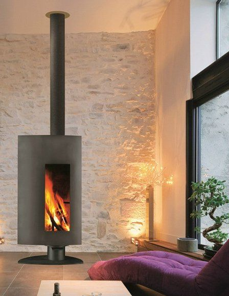 Wood-burning free standing #fireplace STOFOCUS by Focus | #design Dominique Imbert