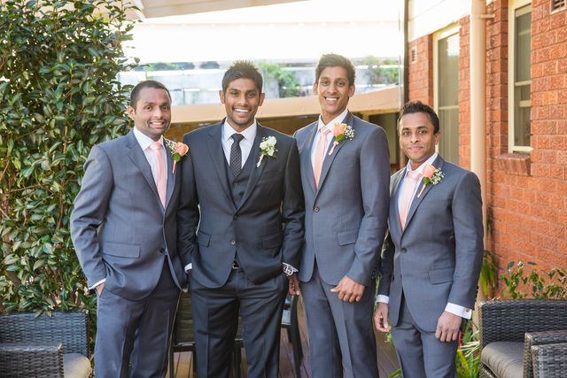 InStitchu classic notch lapel charcoal and grey groom and groomsmen suits. Differentiate the groom by putting him in a darker shade and add a vest.