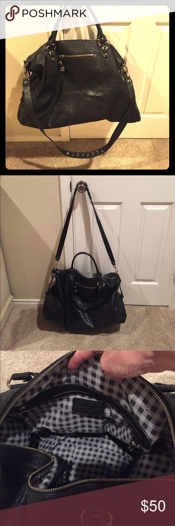 Leather Travel Bag Travel in style with this lovely Jessica Simpson black leather weekender! Outside zippered pocket on each side. Zippered inside pocket plus two additional small pockets. Cute checked lining. Detachable shoulder strap.  This classic will get better with age! Jessica Simpson Bags Travel Bags