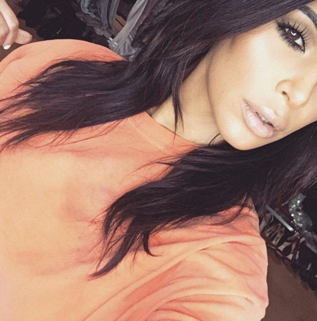 That's not like you, Kim! Kardashian covers up for once as the stars wear orange to suppor...