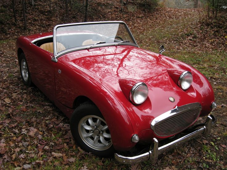 "This is a Healey Sprite, often affectionately known as a ""bugeye"" Sprite.  The car shares its basic chassis and major components with an MG Midget.  These cars were quite small, but were great looking and handling cars.  And, they always look happy.  See the smile on its face?"