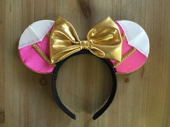 Aurora inspired Mouse Ears from a Disney Classic, Sleeping Beauty.  The mouse ear/headbands is made with various fabric and trim and finished