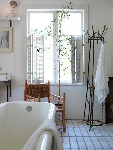 shutters on windows, coat tree for towels  robe is an awesome idea.