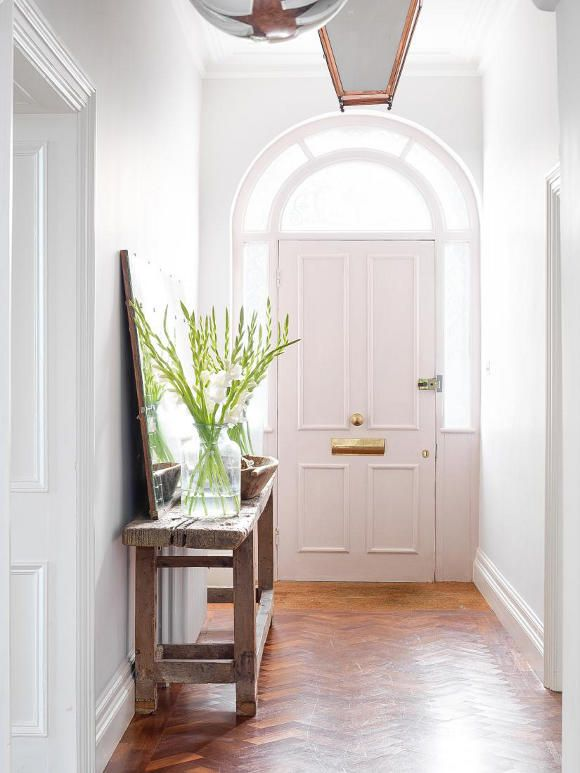 basic lovely entrance hallway... archway doors and a touch of green