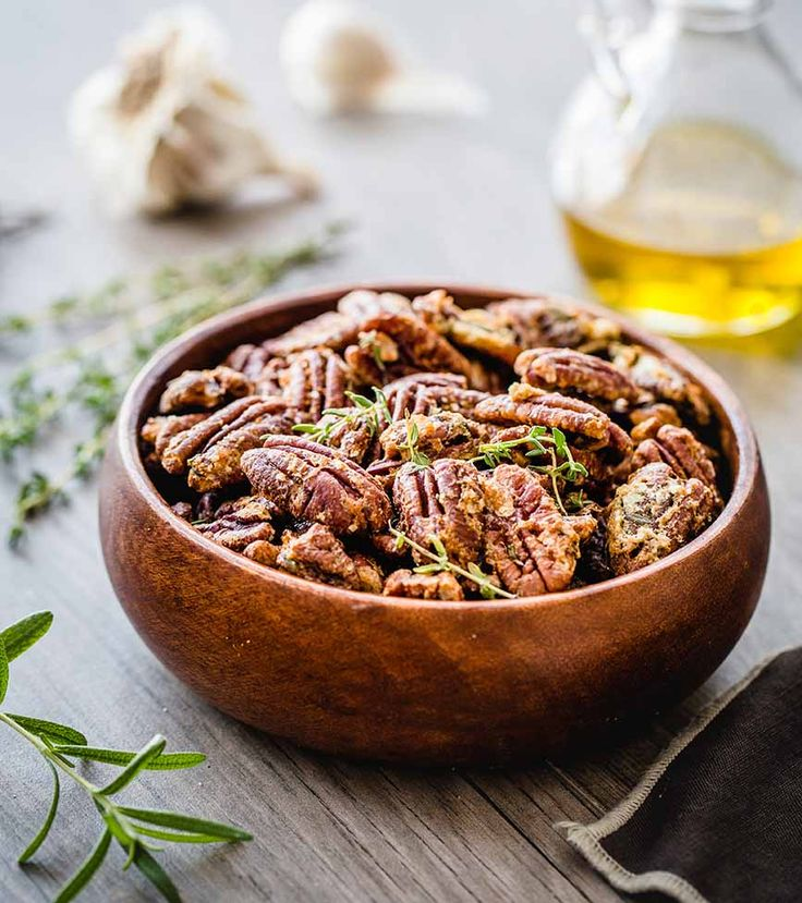 Fresh herbs and garlic powder combine with naturally sweet pecans for a savory snack.