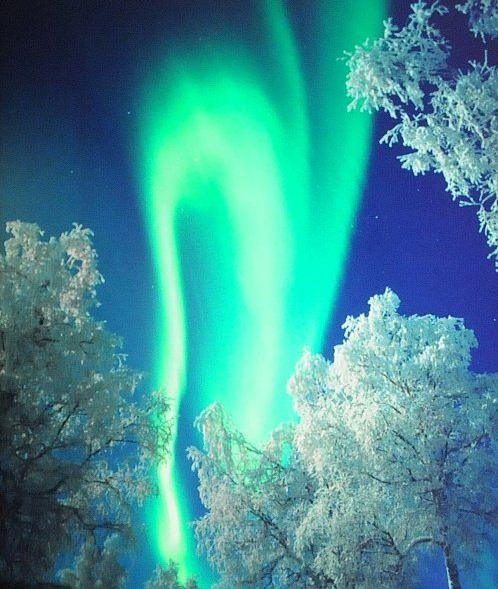 Beautiful bluish northern lights in Iceland. It´s like a candle in the ice-cold wind here in Iceland. For more on the northern lights in Iceland: www.northernlight...