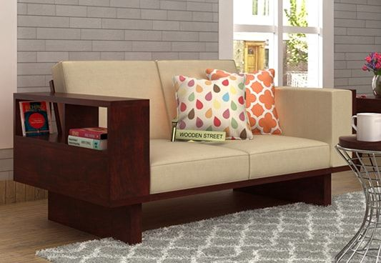 Buy Lannister 2 Seater Wooden Sofa Cream with Mahogany Finish. This two seater sofa with storage is great choice to make as it would house some stuff for you. The organized look will make the space far better. Shop 2 seater sofa online in #Bangalore #Pune #Chennai
