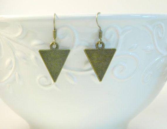 Bronze triangle dangle earrings , bronze arrow drop earrings on a bronze ear hook . Zinc and lead free. Simple earring