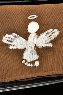 Hand-print (and foot-print) angel - I want to do these on burlap and turn them into pillows.