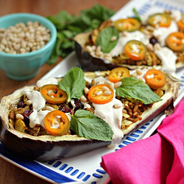A delicious, vegetarian Fall dish: Farro Stuffed Eggplants with Pickled Jalapeños and Tahini Yogurt Sauce