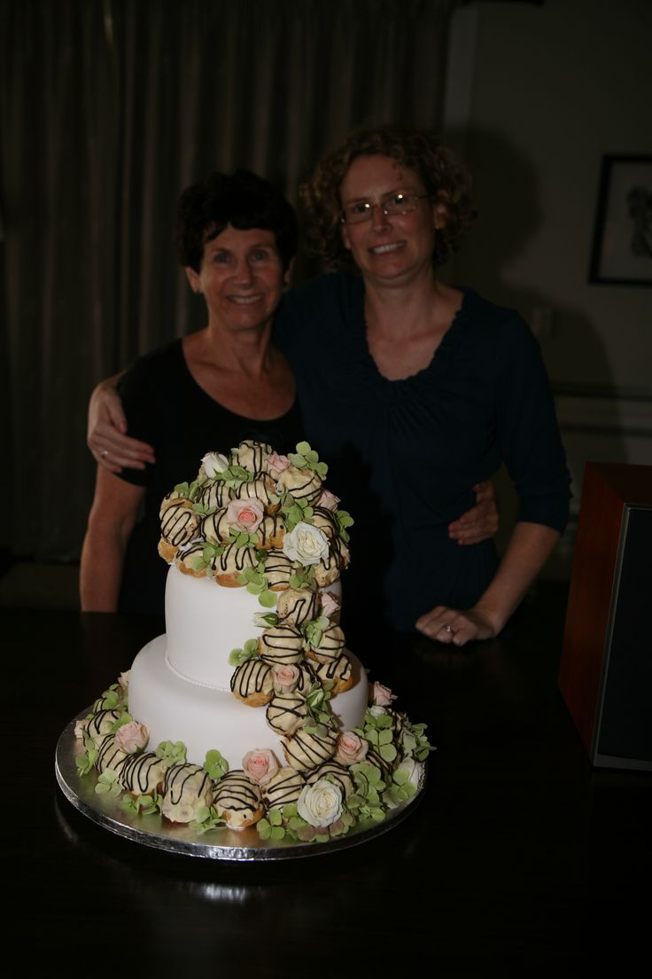 My daughter Janine and myself make and assemble the cream puffs at the wedding, cake made before hand
