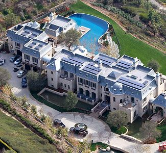 This NFL quarterback and his supermodel wife recently moved into the Mediterranean-style villa they had built in one of the nation's wealthiest neighborhoods.