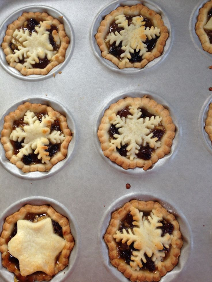 Mince pies with snowflake and star lids