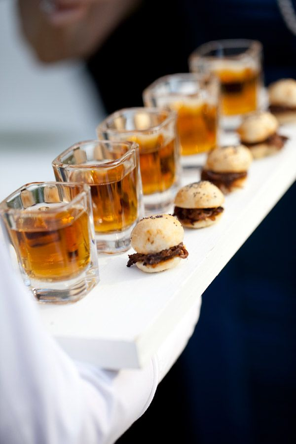 Guy appeal in mini appetizers- BBQ pork sliders with shots of ale.  Peter Callahan catering