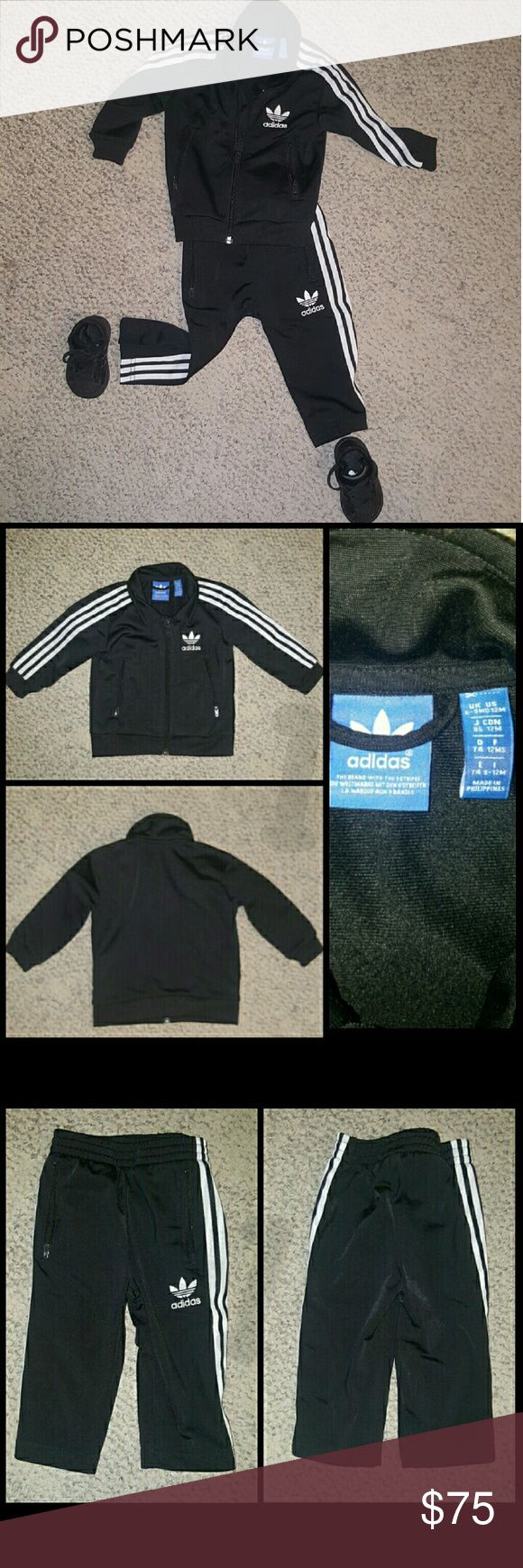"Adidas Track Suit & Originals Superstar2 Sneakers TRACK SUIT-12 mths (Black w/ white stripes):  Jacket: 10"" inseam; Zip pockets; Full zip with stand-up collar; Ribbed cuffs and hem; Contrast 3-Stripes on sleeves; Printed Trefoil logo on left chest Pants: Elastic waist; Contrast 3-Stripes on sides; zip pockets; Printed Trefoil logo on left leg  SNEAKERS-US size 3K (All Black): Leather Rubber sole Classic fashion sneaker with tonal three stripes featuring lace-up closure and non-marking…"