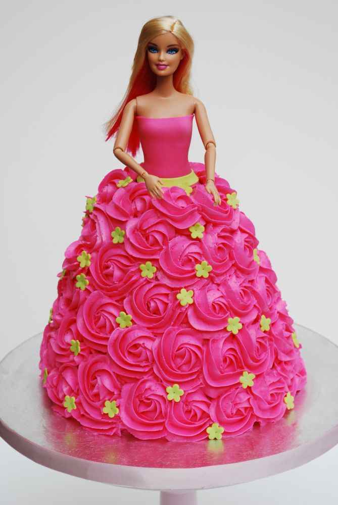 I had one of these on one of my birthdays as a child.  mine was yellow!   Pink Rosette Barbie Cake