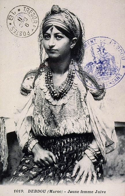 Africa | Portrait of a Jewish Berber girl from Debdou, Morocco. ca. 1915. | Scanned postcard image, photographer unknown.