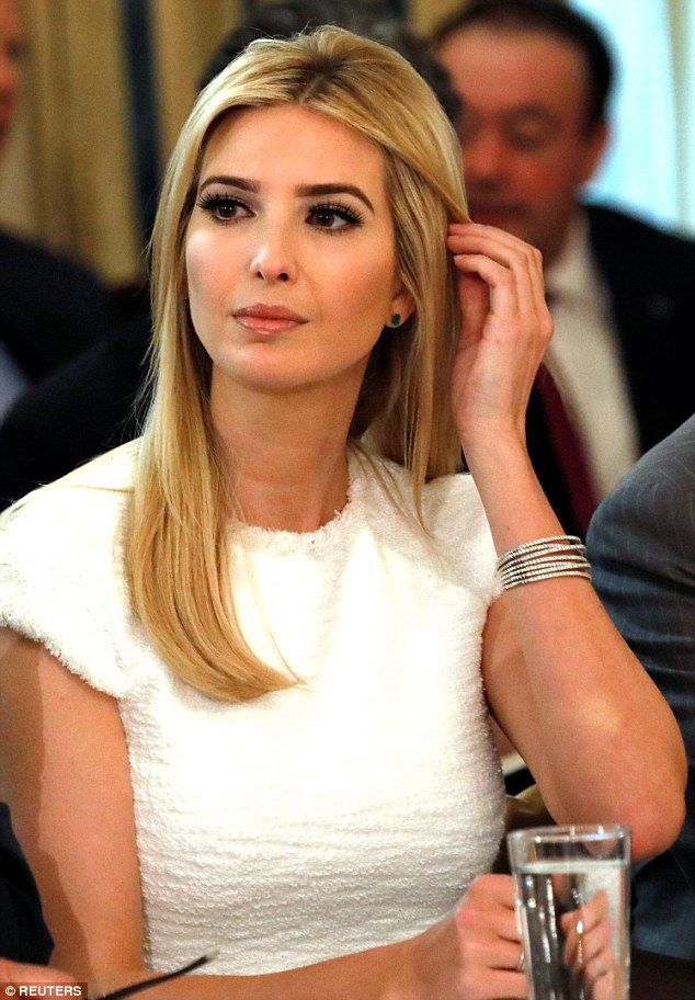 Sitting pretty: Ivanka Trump attended her father Donald's meeting with manufacturing CEOs in the State Dining Room in the White House on Thursday