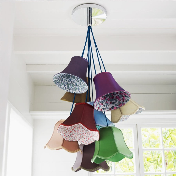 How fun would this be on a porch or in a breakfast nook?  I love it!  Emily Saloon Chandelier