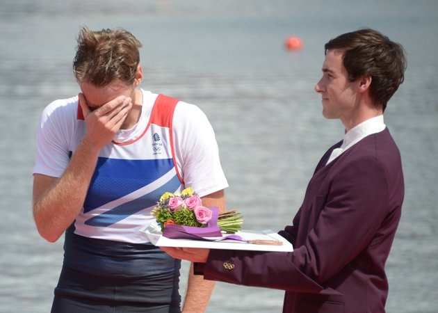 Great Britain's Alan Campbell cries as he receives his bronze medal on the podium, for the men's single sculls final A of the rowing event during the London 2012 Olympic Games, at Eton Dorney Rowing Centre in Eton, west of London, on August 3, 2012. (DAMIEN MEYER/AFP/Getty Images)